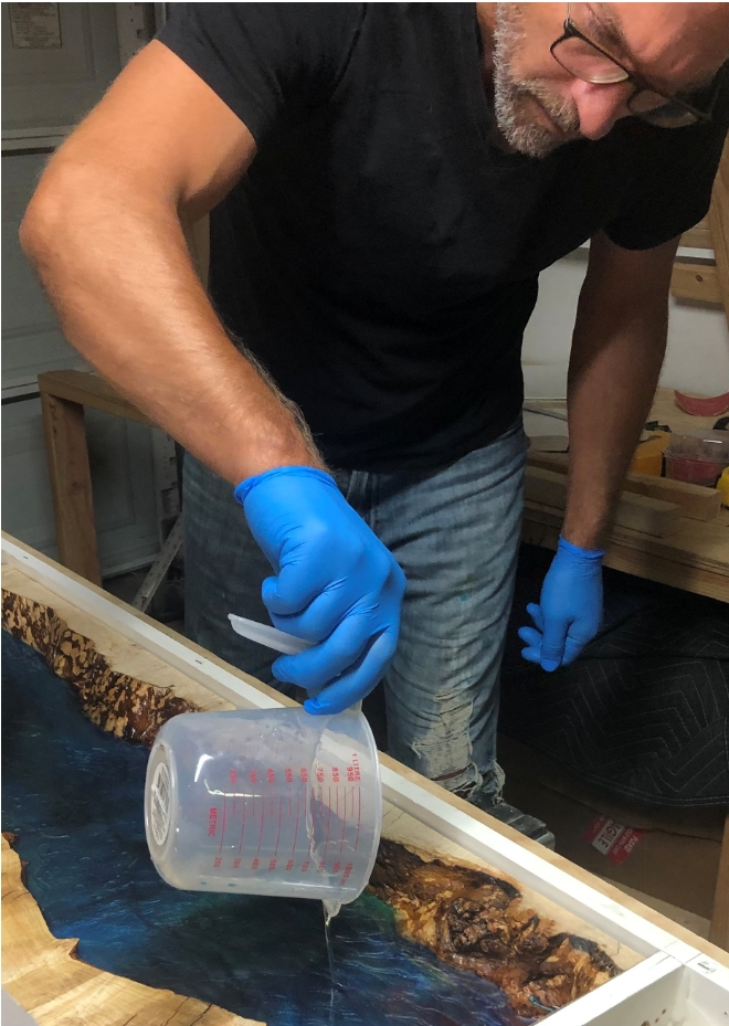 Noah Witenstein in the process of casting Entropy Resin