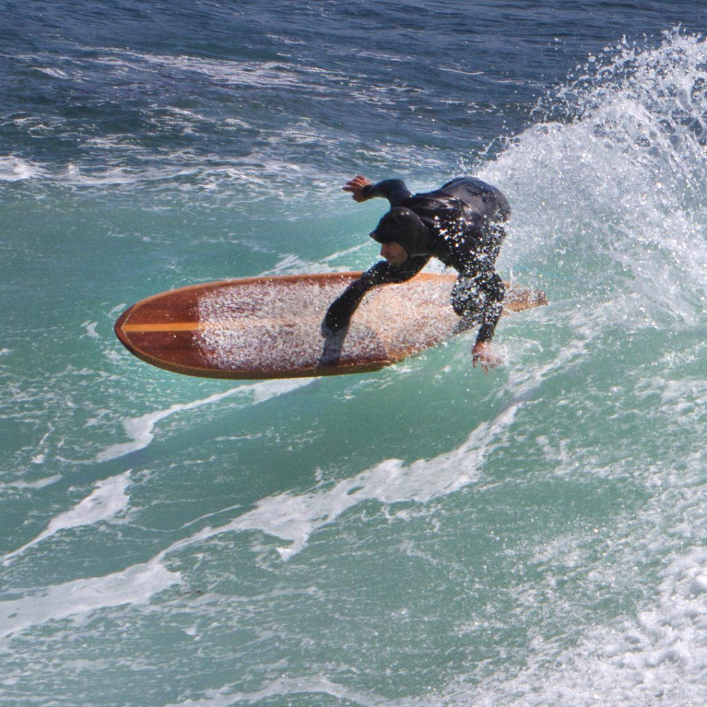 Tyler Fox carving the waves on a Ventana surfboard